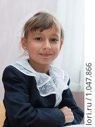 Купить «Ученица в школьной форме за партой», фото № 1047866, снято 20 августа 2009 г. (c) Оксана Гильман / Фотобанк Лори