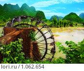 Купить «Бамбуковое водяное колесо. Вьетнам», фото № 1062654, снято 15 августа 2009 г. (c) Ольга Хорошунова / Фотобанк Лори