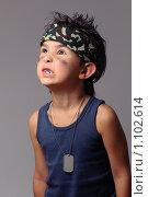 Купить «Мальчик в военной бандане и боевой раскраске кричит», фото № 1102614, снято 17 сентября 2009 г. (c) Ксения Крылова / Фотобанк Лори