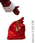 Купить «Рука Деда Мороза указывает на красный мешок с новогодними подарками, на белом фоне», фото № 1127178, снято 1 октября 2009 г. (c) Алексей Рогожа / Фотобанк Лори