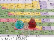 Купить «Три колбы с растворами химических реактивов», фото № 1245670, снято 2 ноября 2009 г. (c) Алёна Кухтина / Фотобанк Лори