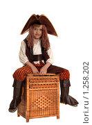 Купить «Мальчик в костюме пирата на плетеном коробе. Изолировано», фото № 1258202, снято 18 ноября 2009 г. (c) Юлия Кашкарова / Фотобанк Лори