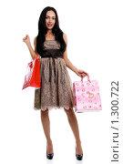 Купить «Молодая женщина с покупками», фото № 1300722, снято 31 октября 2009 г. (c) Андрей Аркуша / Фотобанк Лори