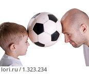 Купить «Папа с сыном играют в футбол», фото № 1323234, снято 6 ноября 2009 г. (c) Илья Андриянов / Фотобанк Лори
