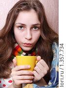 Купить «Девушка дует на горячий напиток. Болеет.», фото № 1357734, снято 20 декабря 2009 г. (c) Ирина Золина / Фотобанк Лори
