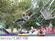 Купить «Мальчик на карусели», фото № 1367158, снято 23 августа 2009 г. (c) Anna Kavchik / Фотобанк Лори