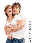 Купить «Счастливая молодая пара на белом фоне», фото № 1375854, снято 9 января 2010 г. (c) Петр Кириллов / Фотобанк Лори