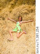 Купить «Девочка лежит на стоге сена», фото № 1381254, снято 1 июля 2008 г. (c) Сергей Шульгин / Фотобанк Лори