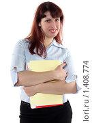 Купить «Портрет молодой девушки с бумагами», фото № 1408774, снято 22 ноября 2009 г. (c) Наталья Белотелова / Фотобанк Лори
