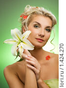 Купить «Девушка с лилией», фото № 1424270, снято 24 января 2009 г. (c) Andrejs Pidjass / Фотобанк Лори