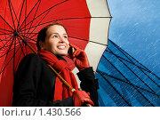 Купить «Девушка с красным зонтом разговаривает по телефону», фото № 1430566, снято 9 апреля 2008 г. (c) Andrejs Pidjass / Фотобанк Лори