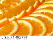 Купить «Фон из долек спелого апельсина», фото № 1482714, снято 16 января 2009 г. (c) Андрей Бурдюков / Фотобанк Лори