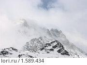 Купить «Вершина горы в облаках», фото № 1589434, снято 21 марта 2010 г. (c) Семин Илья / Фотобанк Лори