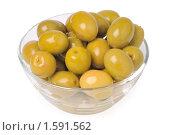 Купить «Оливки в стеклянной ёмкости на белом фоне», фото № 1591562, снято 2 января 2010 г. (c) Денис Ларкин / Фотобанк Лори