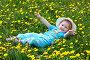 Девочка в одуванчиках, фото № 1614814, снято 30 мая 2009 г. (c) Хайрятдинов Ринат / Фотобанк Лори