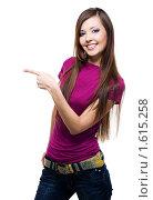 Купить «Девушка показывает пальцем в сторону», фото № 1615258, снято 13 марта 2010 г. (c) Валуа Виталий / Фотобанк Лори