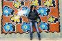 Девушка у стены с граффити, фото № 1635422, снято 17 апреля 2010 г. (c) Ткачёва Ольга / Фотобанк Лори