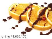 Купить «Апельсиновый десерт с шоколадной глазурью», фото № 1665170, снято 9 октября 2009 г. (c) ElenArt / Фотобанк Лори