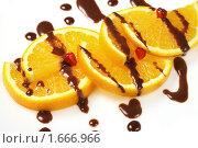 Купить «Апельсиновый десерт с шоколадной глазурью», фото № 1666966, снято 9 октября 2009 г. (c) ElenArt / Фотобанк Лори