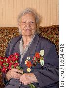 Купить «Женщина, жившая в блокадном Ленинграде и работавшая на победу», фото № 1694418, снято 24 апреля 2010 г. (c) Наталия Полетаева / Фотобанк Лори