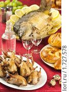 Праздничный стол с карпом, перепелами, водкой и выпечкой, эксклюзивное фото № 1727578, снято 24 мая 2010 г. (c) Лисовская Наталья / Фотобанк Лори