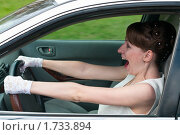 Купить «Девушка за рулем автомобиля», фото № 1733894, снято 12 мая 2010 г. (c) Кекяляйнен Андрей / Фотобанк Лори