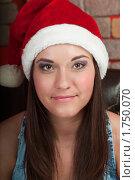Купить «Симпатичная девушка в шапке Санта-Клауса», фото № 1750070, снято 19 декабря 2009 г. (c) Кекяляйнен Андрей / Фотобанк Лори