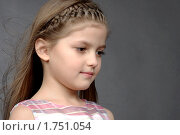 Купить «Девочка в розовом платье смотрит вниз», фото № 1751054, снято 21 февраля 2010 г. (c) Наталия Ефимова / Фотобанк Лори