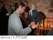 Купить «Прихожане ставят свечи в церкви», фото № 1777030, снято 22 августа 2009 г. (c) Николай Гернет / Фотобанк Лори