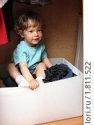 Купить «Ребенок в шкафу», фото № 1811522, снято 2 мая 2010 г. (c) yarruta / Фотобанк Лори