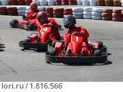 Купить «Картинг. Соревнование гонщиков на трассе», фото № 1816566, снято 18 апреля 2010 г. (c) Татьяна Белова / Фотобанк Лори