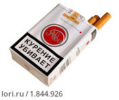 Купить «Предупреждающая надпись о вреде курения на пачке сигарет», фото № 1844926, снято 17 июля 2010 г. (c) Владимир Сергеев / Фотобанк Лори