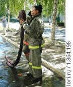 Пожарные потушили огонь (2010 год). Редакционное фото, фотограф Татьяна Уваровская / Фотобанк Лори