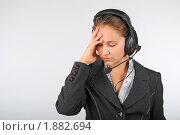 Купить «Девушка на работе, устала, болит голова», фото № 1882694, снято 3 августа 2010 г. (c) Татьяна Юни / Фотобанк Лори