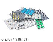 Купить «Упаковки с разными таблетками, изолированы на белом фоне», фото № 1988458, снято 16 декабря 2009 г. (c) ElenArt / Фотобанк Лори