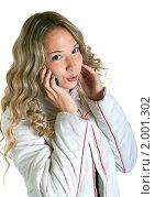 Купить «Девушка в белой куртке с сотовым телефоном», фото № 2001302, снято 26 сентября 2010 г. (c) Виктория Кириллова / Фотобанк Лори