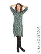 Купить «Молодая привлекательная женщина, стоящая со скрещенными ногами, руки за головой», фото № 2027554, снято 25 февраля 2010 г. (c) Losevsky Pavel / Фотобанк Лори