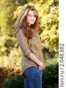 Купить «Портрет красивой девушки на фоне осенний листвы», фото № 2048882, снято 8 октября 2010 г. (c) Андрей Аркуша / Фотобанк Лори