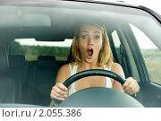 Купить «Напуганная женщина за рулем автомобиля», фото № 2055386, снято 30 августа 2010 г. (c) Валуа Виталий / Фотобанк Лори