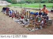 Купить «Торговец сувенирами в городе Вирпазар, Черногория», эксклюзивное фото № 2057186, снято 12 сентября 2010 г. (c) Константин Косов / Фотобанк Лори