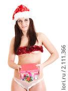 Купить «Полуобнаженная снегурочка с подарком», фото № 2111366, снято 30 октября 2010 г. (c) Сергей Дубров / Фотобанк Лори