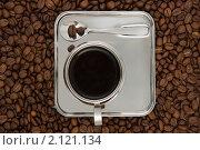 Купить «Чашка кофе на фоне кофейных зерен. Вид сверху», фото № 2121134, снято 7 ноября 2010 г. (c) Татьяна Белова / Фотобанк Лори
