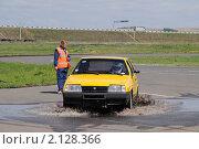 Купить «Желтый автомобиль ВАЗ 2108 едет через лужу», фото № 2128366, снято 6 июня 2010 г. (c) Юрий Андреев / Фотобанк Лори
