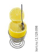Купить «Яркий лимон в подставке для яиц с ложкой на белом фоне», фото № 2129098, снято 2 ноября 2010 г. (c) Светлана Зарецкая / Фотобанк Лори