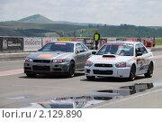 Купить «Две спортивный машины на старте», фото № 2129890, снято 6 июня 2010 г. (c) Юрий Андреев / Фотобанк Лори