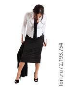 Купить «Девушка в деловом костюме смотрит себе под ноги», фото № 2193754, снято 15 августа 2010 г. (c) Сергей Дубров / Фотобанк Лори