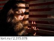 Купить «Женщина с распущенными длинными волосами подглядывает», фото № 2315078, снято 1 октября 2009 г. (c) Losevsky Pavel / Фотобанк Лори