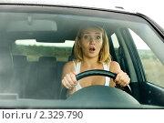 Купить «Испуганная женщина за рулем», фото № 2329790, снято 30 августа 2010 г. (c) Валуа Виталий / Фотобанк Лори