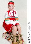 Купить «Девочка в русской народной одежде и больших лаптях», фото № 2337122, снято 11 февраля 2011 г. (c) RedTC / Фотобанк Лори
