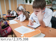 Купить «Контрольная работа в начальной школе», фото № 2375398, снято 25 февраля 2011 г. (c) Федор Королевский / Фотобанк Лори